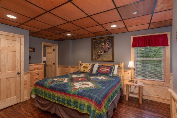 Downstairs bedroom with king bed at Bear Essence, a 2-bedroom cabin rental located in Pigeon Forge