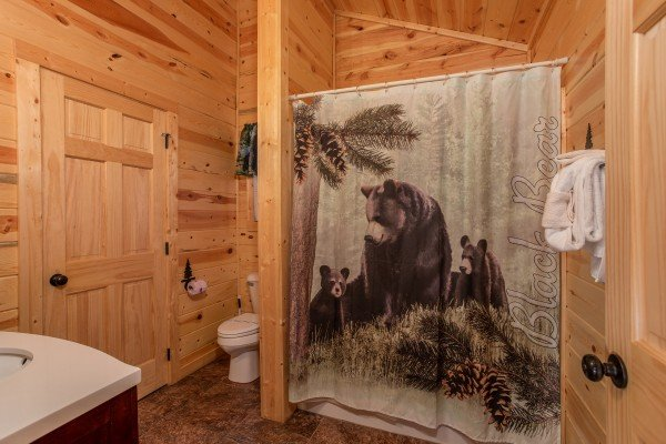 Full bathroom with bear decor at Bear Essence, a 2-bedroom cabin rental located in Pigeon Forge