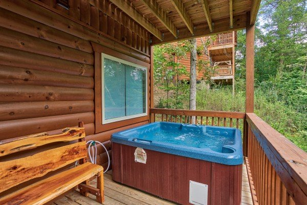 Hot tub on a covered deck at Bear Essence, a 2-bedroom cabin rental located in Pigeon Forge