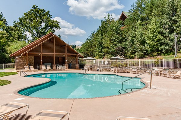 Clubhouse and pool at alpine mountain village at Bear Essence, a 2-bedroom cabin rental located in Pigeon Forge