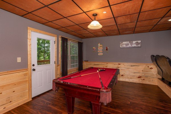 Red felted pool table at Bear Essence, a 2-bedroom cabin rental located in Pigeon Forge