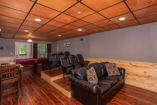Theater room with tiered seating at Bear Essence, a 2-bedroom cabin rental located in Pigeon Forge