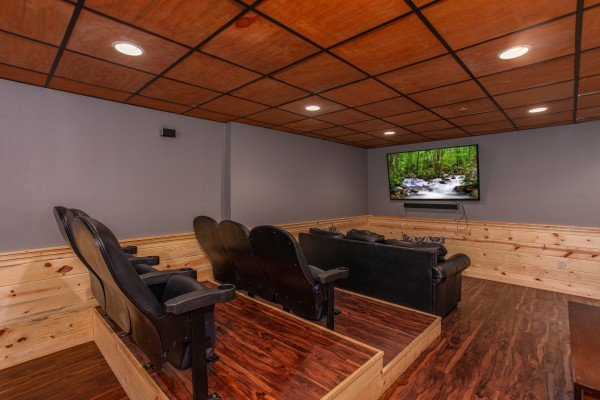 Theater seating and large screen television at Bear Essence, a 2-bedroom cabin rental located in Pigeon Forge