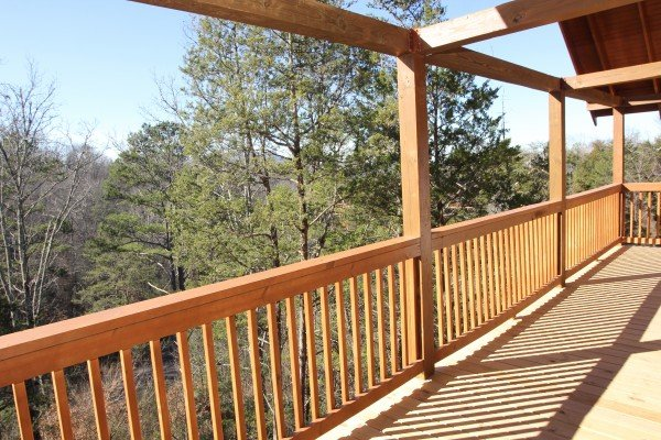 Wooded views from the deck at Bear Essence, a 2-bedroom cabin rental located in Pigeon Forge