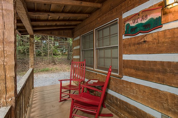 Rocking chairs on the covered front porch at Little Bear, a 1 bedroom cabin rental located in Pigeon Forge