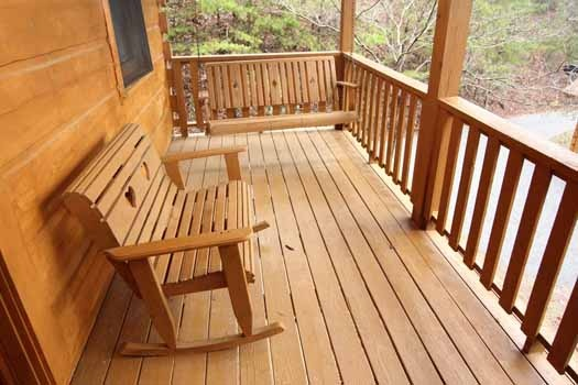 rocking bench on deck at bear tracks a 2 bedroom cabin rental located in pigeon forge