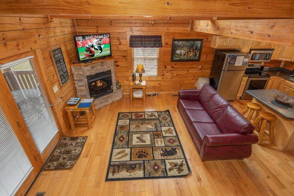 Aerial view of the living room & kitchen at Alpine Tranquility, a 4 bedroom cabin rental located in Pigeon Forge