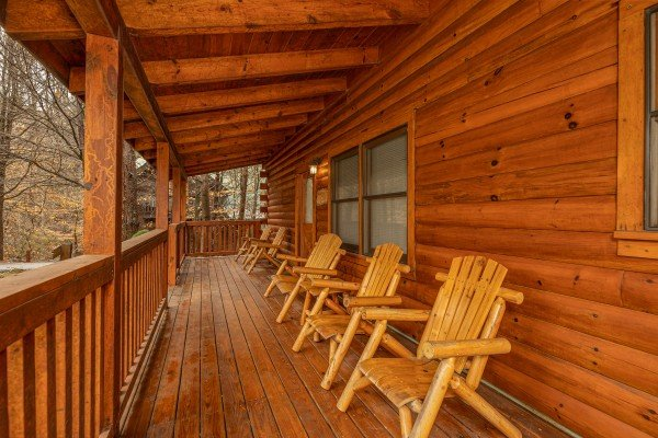Adirondack chairs on a covered deck at Alpine Tranquility, a 4 bedroom cabin rental located in Pigeon Forge