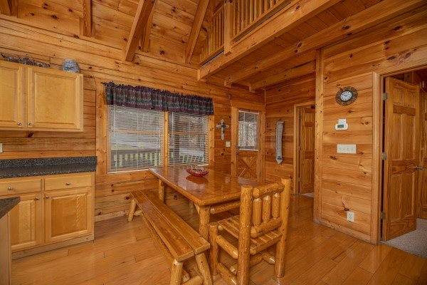 Dining table for six at Alpine Tranquility, a 4 bedroom cabin rental located in Pigeon Forge