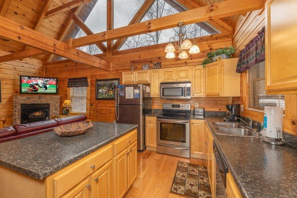 Kitchen and living room at Alpine Tranquility, a 4 bedroom cabin rental located in Pigeon Forge