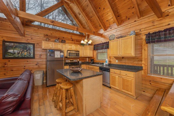 Island and kitchen with stainless appliances at Alpine Tranquility, a 4 bedroom cabin rental located in Pigeon Forge