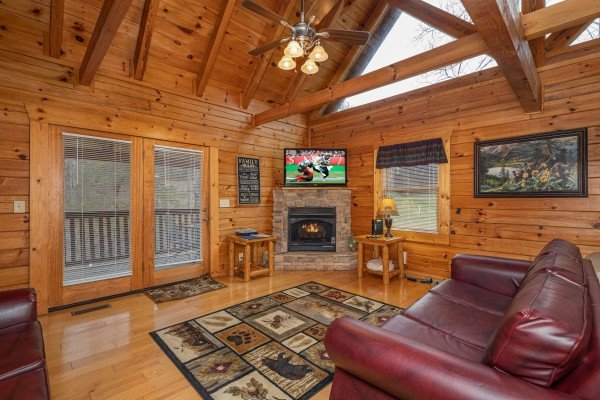 Fireplace & TV in the living room at Alpine Tranquility, a 4 bedroom cabin rental located in Pigeon Forge