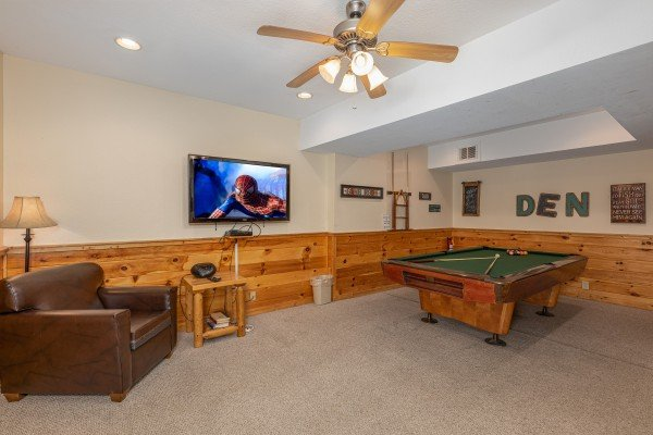 Lower level living room with pool table at Alpine Tranquility, a 4 bedroom cabin rental located in Pigeon Forge