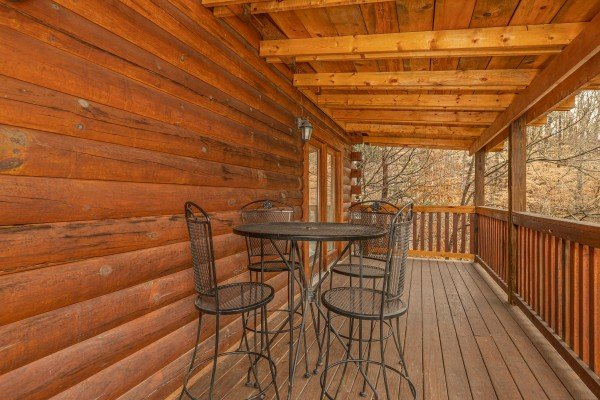 Deck dining for four at Alpine Tranquility, a 4 bedroom cabin rental located in Pigeon Forge