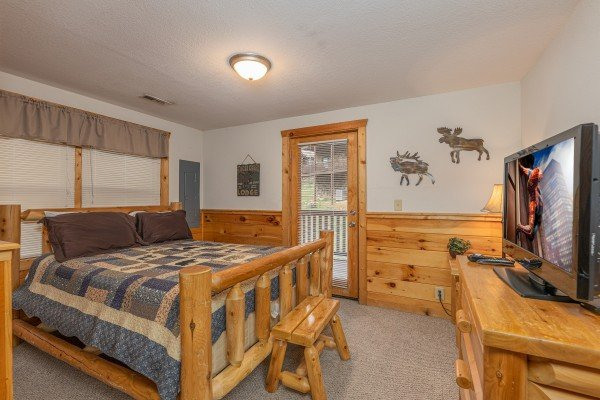 Bedroom with a queen log bed at Alpine Tranquility, a 4 bedroom cabin rental located in Pigeon Forge