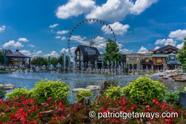 the fountain and ferris wheel at the island near alpine tranquility a 4 bedroom cabin rental located in pigeon forge