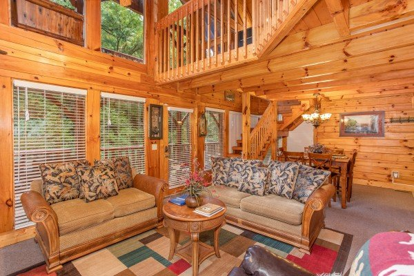 Two loveseats in the living room at Smokey Max Cabin, a 2 bedroom cabin rental located in Pigeon Forge