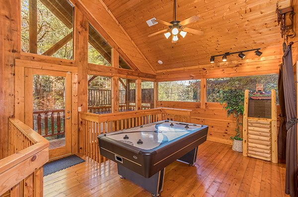 Air hockey table at Smokey Max Cabin, a 2 bedroom cabin rental located in Pigeon Forge