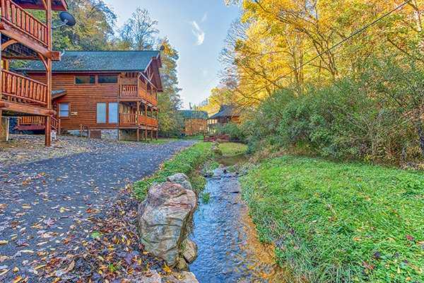 Driveway and creek at Smokey Max Cabin, a 2 bedroom cabin rental located in Pigeon Forge