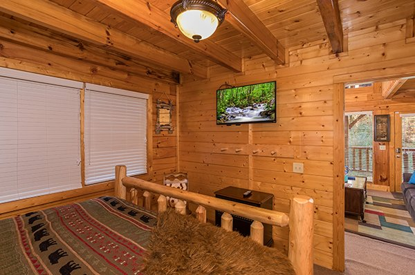 King bedroom with a tv at Smokey Max Cabin, a 2 bedroom cabin rental located in Pigeon Forge
