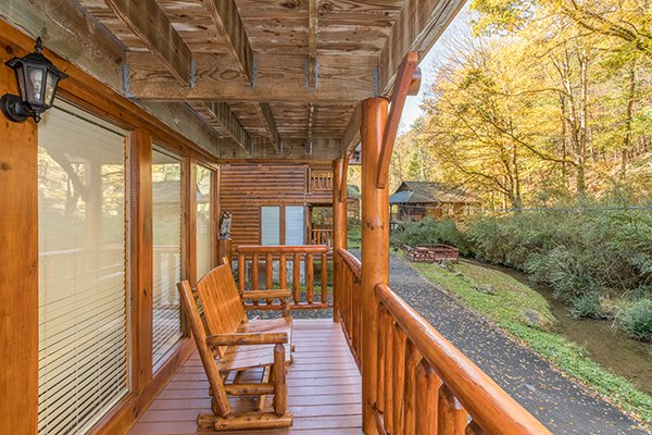 Rocking bench on the lower deck at Smokey Max Cabin, a 2 bedroom cabin rental located in Pigeon Forge