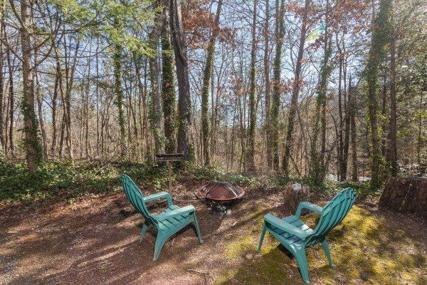 Fire pit and chairs at Snuggle Inn, a 2 bedroom cabin rental located in Pigeon Forge