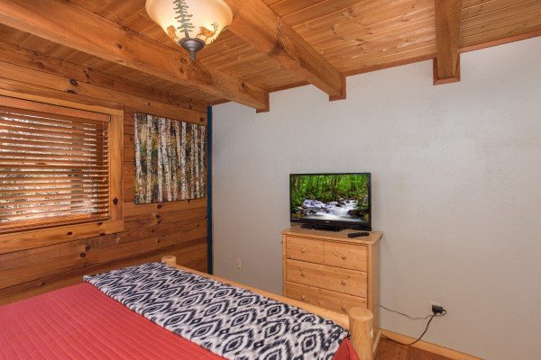 Dresser and TV at Snuggle Inn, a 2 bedroom cabin rental located in Pigeon Forge