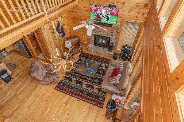 Looking down at the living room at 1 Awesome View, a 3 bedroom cabin rental located in Pigeon Forge