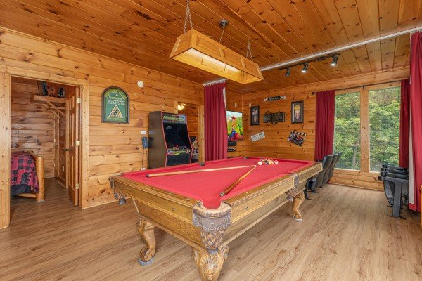 Game room with pool table and video game at 1 Awesome View, a 3 bedroom cabin rental located in Pigeon Forge