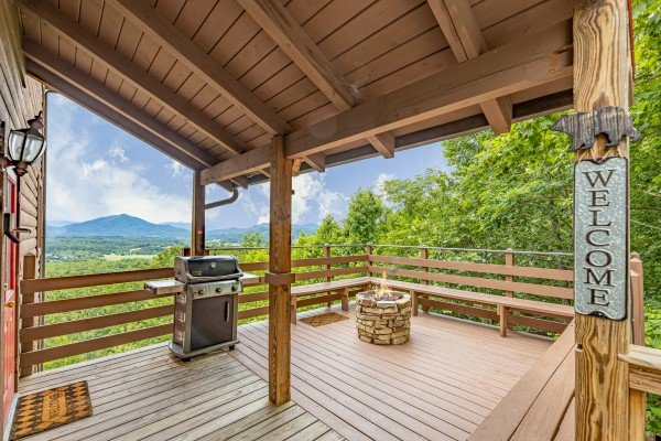 Grill and firepit on a deck at 1 Awesome View, a 3 bedroom cabin rental located in Pigeon Forge