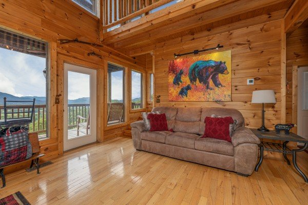 Sofa in the living room at 1 Awesome View, a 3 bedroom cabin rental located in Pigeon Forge