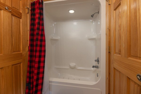 Bathroom with a tub and shower at 1 Awesome View, a 3 bedroom cabin rental located in Pigeon Forge