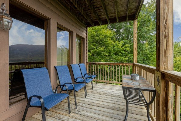 Deck with four chairs at 1 Awesome View, a 3 bedroom cabin rental located in Pigeon Forge