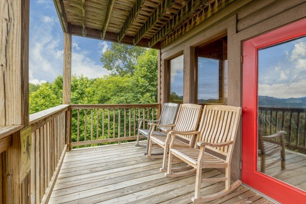 Rocking chairs on a deck at 1 Awesome View, a 3 bedroom cabin rental located in Pigeon Forge
