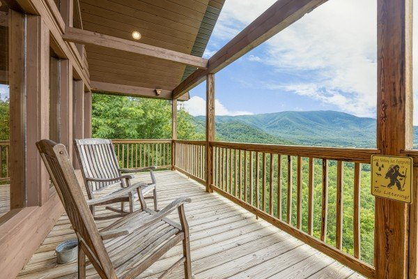 Covered deck with rocking chairs at 1 Awesome View, a 3 bedroom cabin rental located in Pigeon Forge