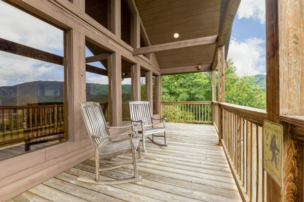 Deck with rocking chairs at 1 Awesome View, a 3 bedroom cabin rental located in Pigeon Forge