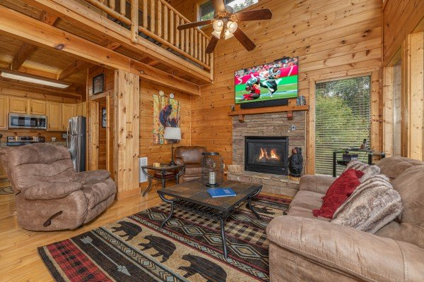 Two recliners and a sofa in the living room at 1 Awesome View, a 3 bedroom cabin rental located in Pigeon Forge