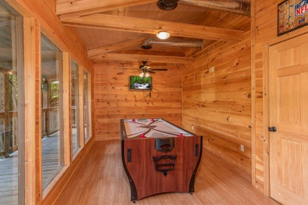 Convertible pool table to air hockey table at License to Chill, a 3 bedroom cabin rental located in Gatlinburg