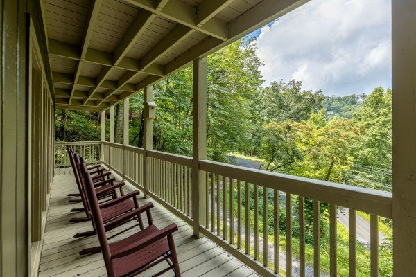 Rocking chairs on a covered deck at License to Chill, a 3 bedroom cabin rental located in Gatlinburg