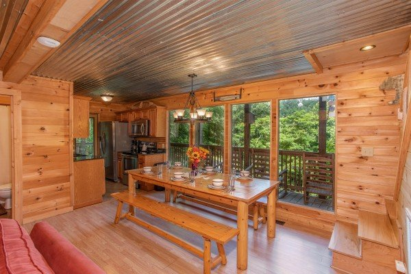 Dining table with bench seating for six at License to Chill, a 3 bedroom cabin rental located in Gatlinburg
