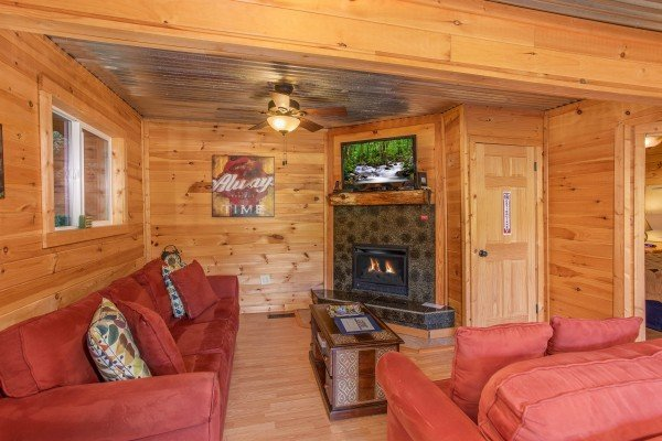 Living room with a corner fireplace and TV at License to Chill, a 3 bedroom cabin rental located in Gatlinburg