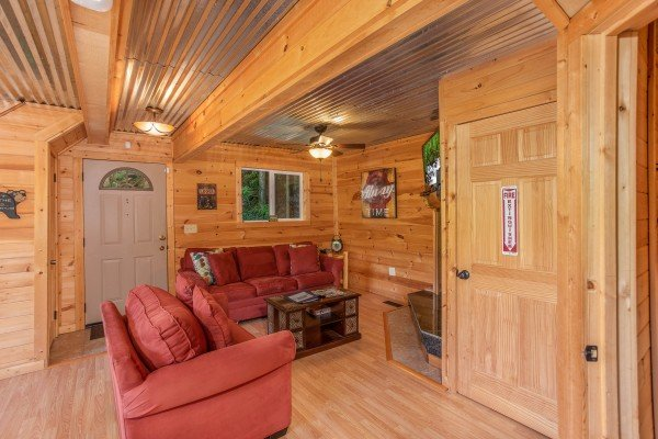 Sofa and loveseat in the living room at License to Chill, a 3 bedroom cabin rental located in Gatlinburg