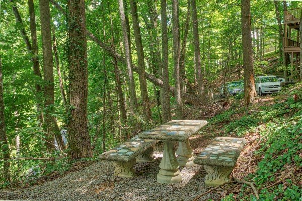 Concrete picnic table on the property at License to Chill, a 3 bedroom cabin rental located in Gatlinburg