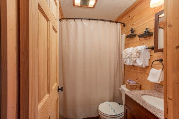 Bathroom with a tub and shower at License to Chill, a 3 bedroom cabin rental located in Gatlinburg