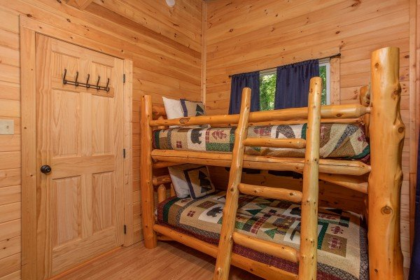 Two sets of twin bunks in a bedroom at License to Chill, a 3 bedroom cabin rental located in Gatlinburg