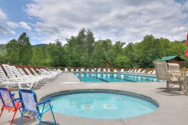 Outdoor pool and spa at Endless View, a 4 bedroom cabin rental located in Pigeon Forge