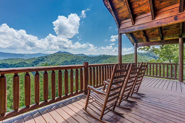 Rocking chairs to take in the sweeping views at Endless View, a 4-bedroom cabin rental located in Pigeon Forge