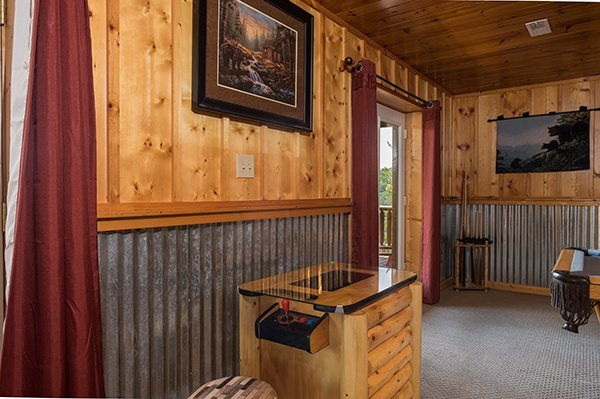 Table top multi game arcade system in the game room at Endless View, a 4-bedroom cabin rental located in Pigeon Forge