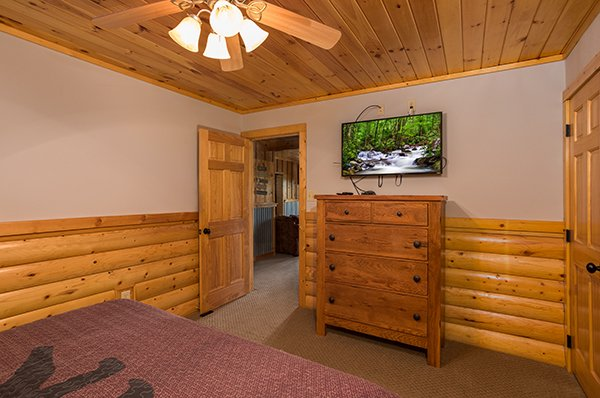 Basement bedroom with a dresser and tv at Endless View, a 4-bedroom cabin rental located in Pigeon Forge