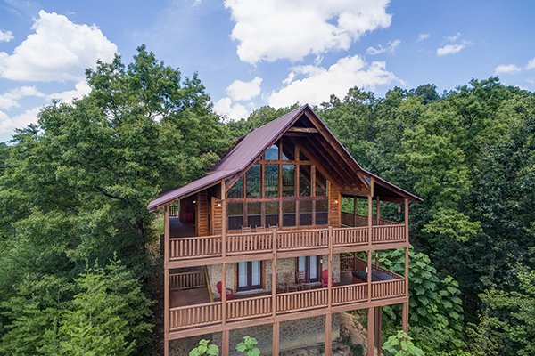 Drone view looking back at the cabin and two levels of covered, wrap-around deck at Endless View, a 4-bedroom cabin rental located in Pigeon Forge